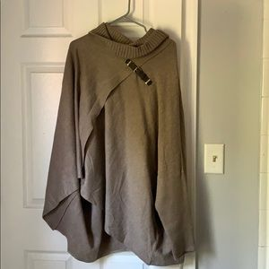 Cape with sleeves